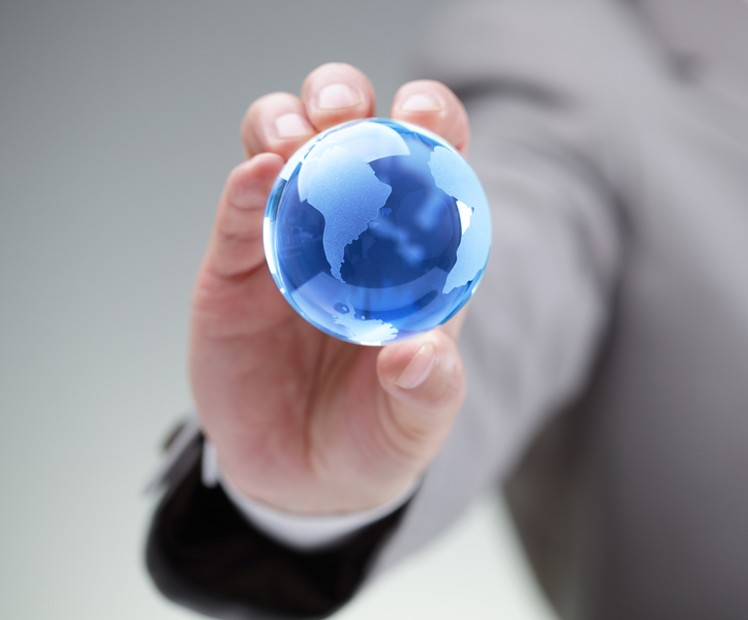 person holding mini globe
